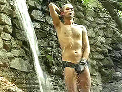 Cute stud enjoying shaving and stroking his cock in nature