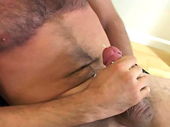 Watch this sexy blue eyed guy stroking is hard rock cock!