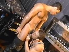 Muscular tattooed guys play blowjob