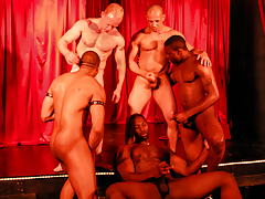 5 moist guys rehearse on stage for a live interracial sex show