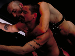 Justin Southhall works over Scott Samson in a down-n-nasty S&M scenario worthy of de Sade himself. Scott, in bondage among two pillars, moans like a good pliant submissive as he is spanked, whipped, spit-on and erotically tortured in any number of cre mature gay