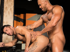 Tattooed Brazilian hunk Bruno Bernal caresses Jason Vario's massive, unchipped cock. Slick precum appears on the tip of Jason's cock, and Bruno smears it across Jason's sensitive head. Sinking to his knees, Bruno takes Jason's hard member in his gorge and