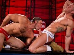 Facing each other on their knees, Johnny V and Derek Atlas bang their foreheads like bulls locking horns. Each man gropes the hard-muscled body confro