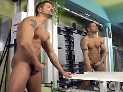 Gay hottie jerking his meat at the gym after his training