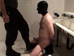 Kneeling on the wetroom floor, mostly naked except for boots mature gay